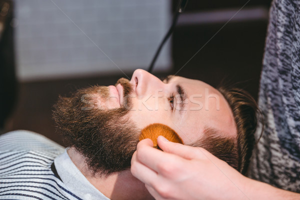 Cleaning clients face after haircut with soft brush  Stock photo © deandrobot