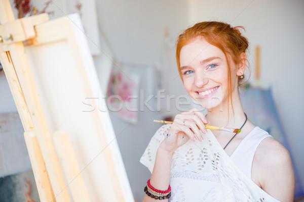 Genç kadın sanatçı boyama Stok fotoğraf © deandrobot
