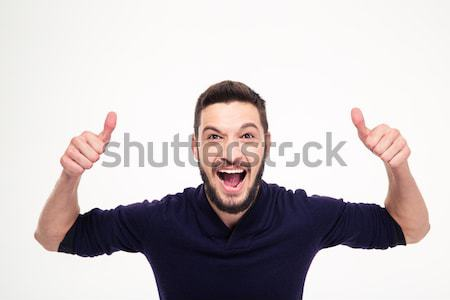 Elated excited young happy man shouting and showing thumbs up  Stock photo © deandrobot