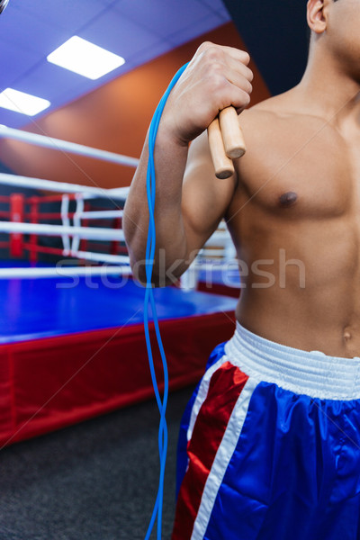 Boxer standing with skipping rope Stock photo © deandrobot