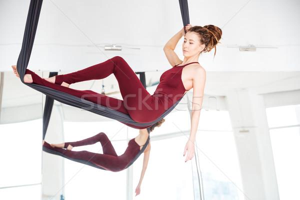 Töprengő fiatal nő jóga függőágy tükör sport Stock fotó © deandrobot