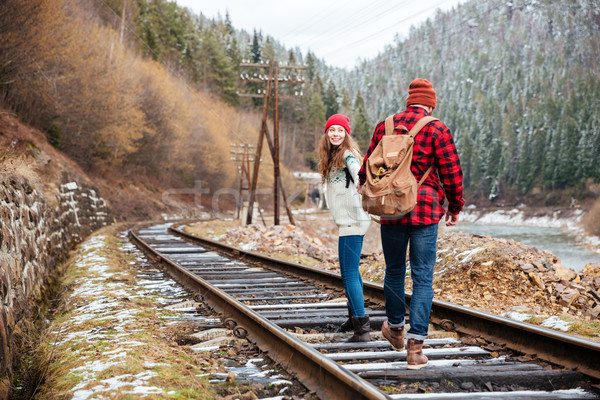 Beautiful couple walking on railroad together Stock photo © deandrobot