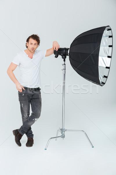 Homme matériel d'éclairage portrait isolé blanche Photo stock © deandrobot