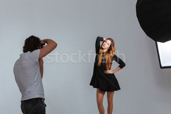 Photographer working with model in studio  Stock photo © deandrobot