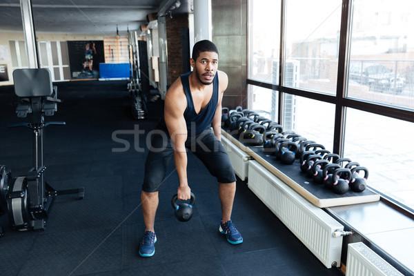 Сток-фото: фитнес · человека · осуществлять · гири · здорового