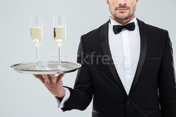 Bril champagne dienblad De ober smoking Stockfoto © deandrobot