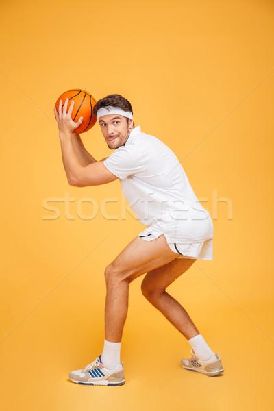 Portret przystojny młodych zagęszczony człowiek gry Zdjęcia stock © deandrobot