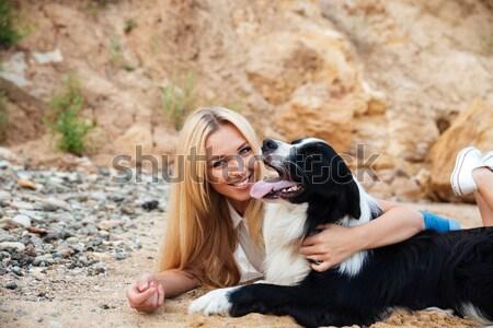 Boldog nő aranyos kutya tengerpart nyár Stock fotó © deandrobot