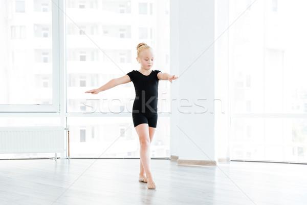 Young little ballet dancing student at a class Stock photo © deandrobot