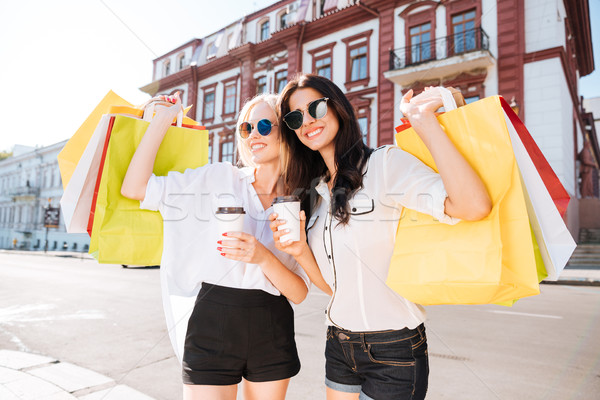Women with shopping bags having fun walking on the street Stock photo © deandrobot