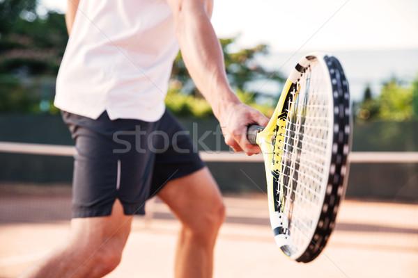 Man playing in tennis Stock photo © deandrobot