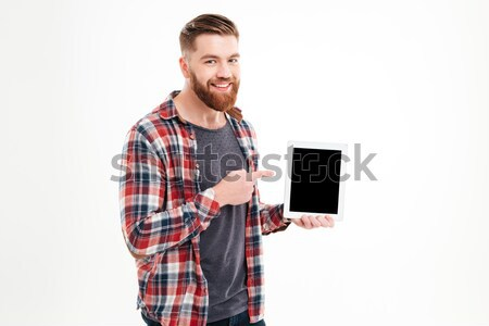 Sorridente barbudo homem indicação dedo Foto stock © deandrobot