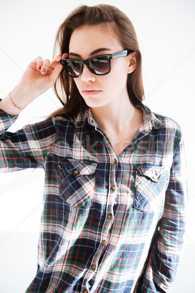 Portrait of beautiful young woman in plaid shirt and sunglasses Stock photo © deandrobot