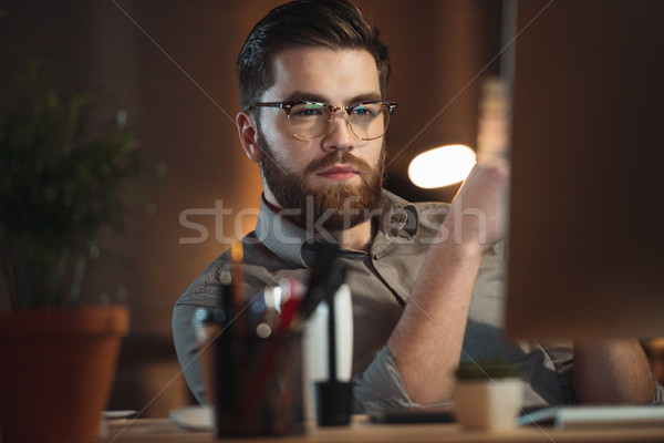 Web designer working late at night and looking to computer. Stock photo © deandrobot