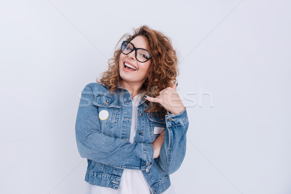 Woman in glasses and jean jacket Stock photo © deandrobot
