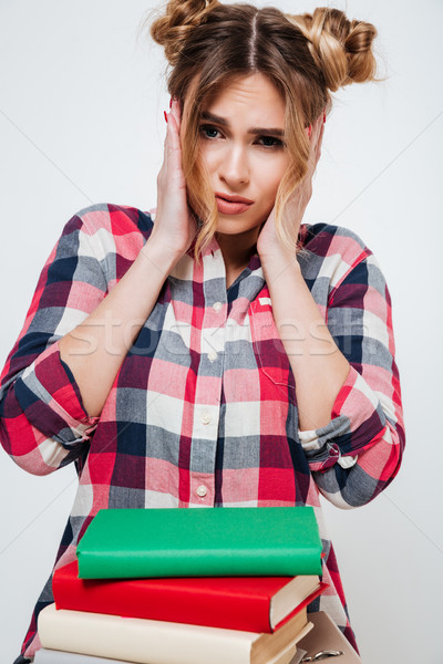 Vertical portrait of Upset Woman in shirt with books Stock photo © deandrobot