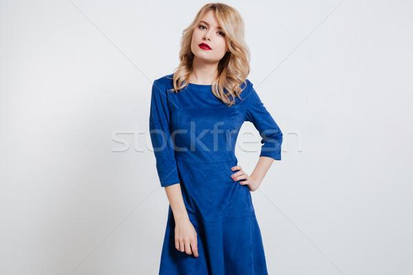 Amazing young lady posing over white background. Stock photo © deandrobot