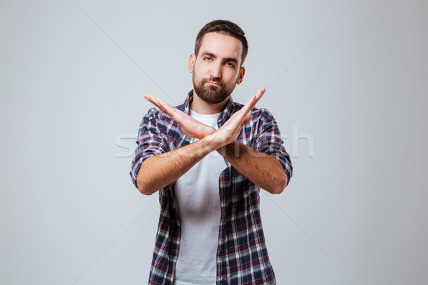Serious Bearded man in shirt showing stop gesture Stock photo © deandrobot