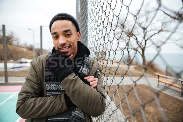 Thoughtful african american young man standing and thinking outdoors Stock photo © deandrobot