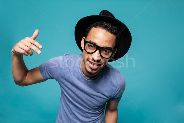 Portrait of a young casual afro american man in hat Stock photo © deandrobot
