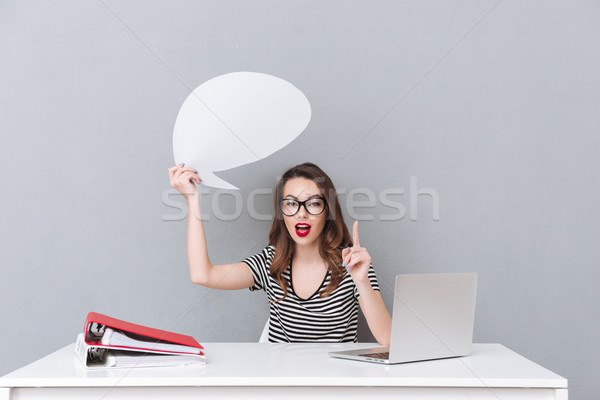 Pretty young lady holding empty speech bubble Stock photo © deandrobot