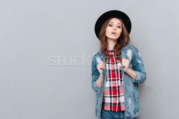 Fiatal elegáns nő kalap kockás póló Stock fotó © deandrobot