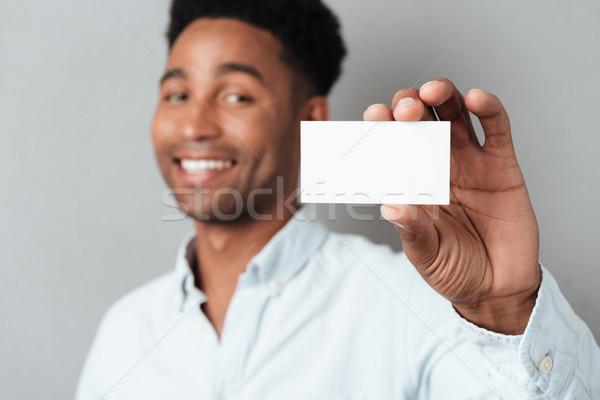 笑みを浮かべて 小さな アフロ アメリカン 男 ストックフォト © deandrobot
