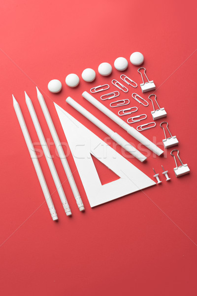 Office supplies on the red background table Stock photo © deandrobot