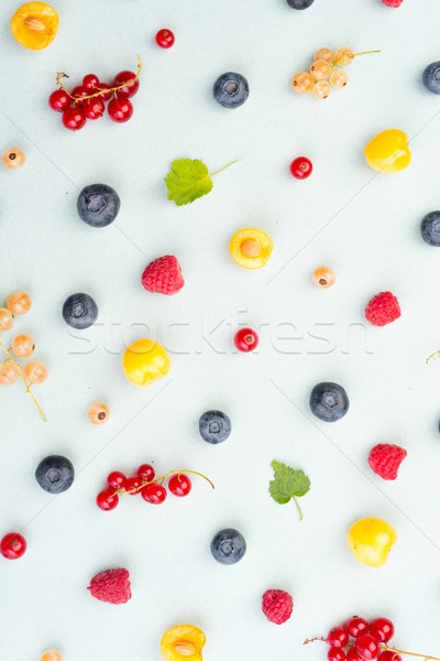 Berries isolated over white background table. Stock photo © deandrobot
