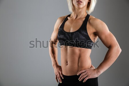 Cropped image of a muscular woman in sportswear Stock photo © deandrobot