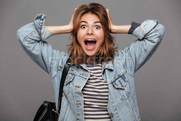 Portrait of a surprised astonished teenage girl Stock photo © deandrobot