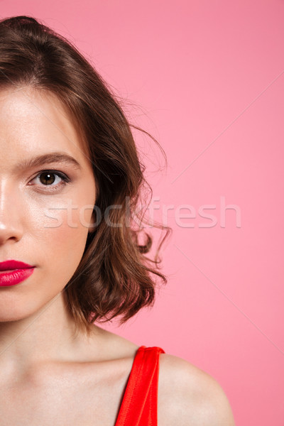 Cropped photo of cheerful young woman with red lips looking at c Stock photo © deandrobot