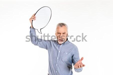 Fiatalember áll izolált tart szövegbuborék kép Stock fotó © deandrobot