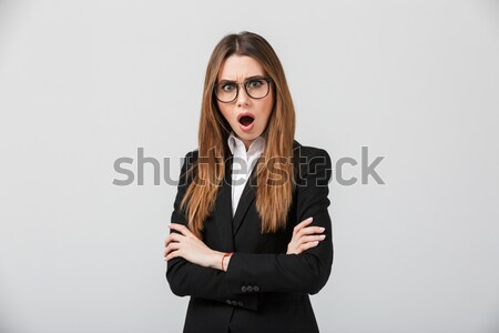 Portrait of an astonished businesswoman dressed in suit Stock photo © deandrobot