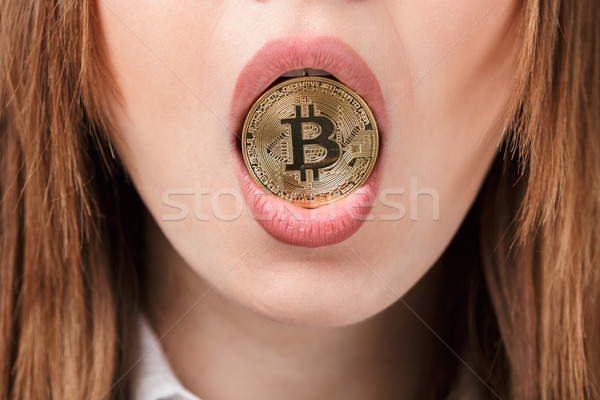 Femme or bitcoin bouche Photo stock © deandrobot