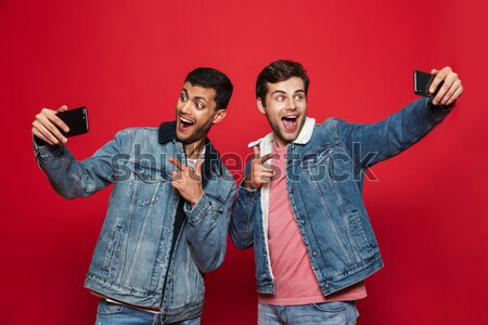 Happy punk couple showing money and looking at the camera Stock photo © deandrobot