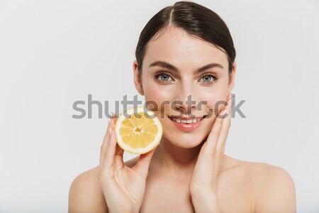 Piękna kobieta pomarańczowy plasterka patrząc Zdjęcia stock © deandrobot