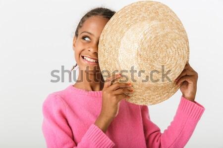 Jonge asian vrouw verbergen achter hoed Stockfoto © deandrobot