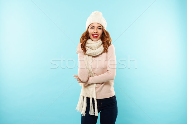 Portrait of a joyful young girl dressed in hat and scarf Stock photo © deandrobot
