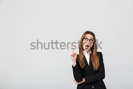 Emotional woman with red lips talking by mobile phone. Stock photo © deandrobot