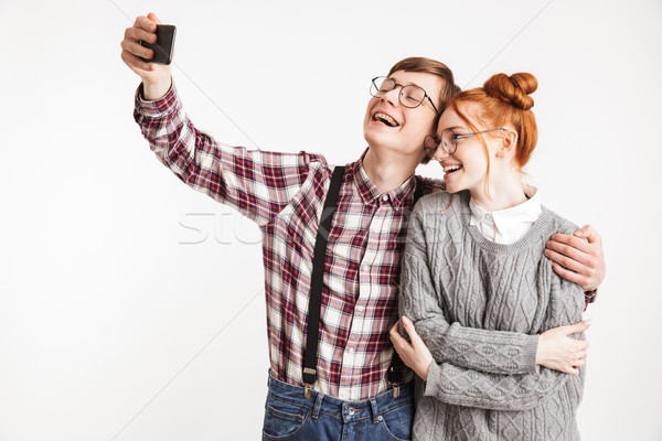 Happy couple of school nerds Stock photo © deandrobot