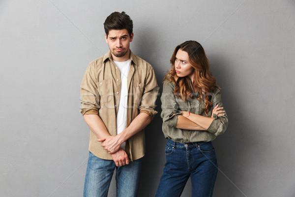 Portrait of an upset young couple having an argument Stock photo © deandrobot