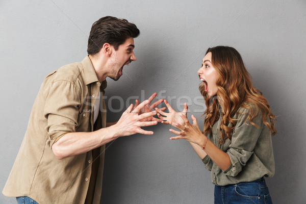 Portrait of an angry young couple having an argument Stock photo © deandrobot