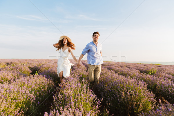 Cheery young couple embracing at the lavender field Stock photo © deandrobot