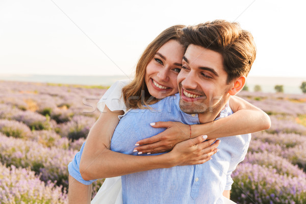 Stock photo: Joyful young couple having fun at the lavender field together