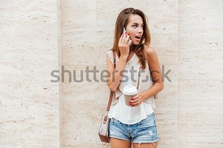 Fiatal szőke nő lány szürke nők fal Stock fotó © deandrobot