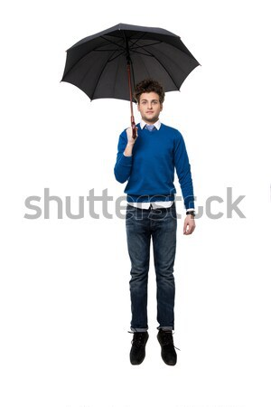 Business man hidden in umbrella and shows fuck off against white background Stock photo © deandrobot