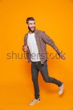Full-length portrait of a happy man over white background Stock photo © deandrobot