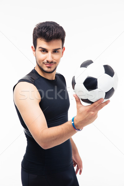 Happy soccer player holding ball Stock photo © deandrobot