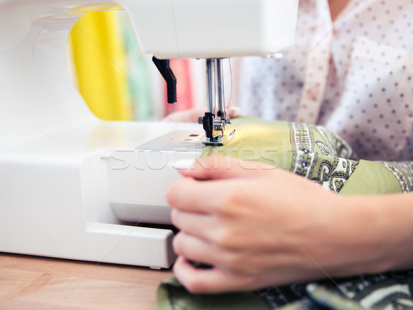 Woman using a sewing machine Stock photo © deandrobot